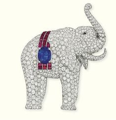 A DIAMOND AND GEM-SET BROOCH, BY CHARLTON. Designed as a pavé-set diamond elephant to a calibré-cut ruby saddle with an oval-shaped sapphire centre weighing carats and onyx eye detail, cm high. Elephant Jewelry, Animal Jewelry, Art Deco Jewelry, Fine Jewelry, Insect Jewelry, Diamond Brooch, Antique Jewelry, Vintage Jewellery, Jewelery