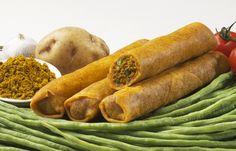 Een Surinaamse rol gevuld met kip, kouseband, aardappels en pittige masala-kruiden. Oóóóó..Switi! Hmmmm geef me een idee om zelf t maken :)