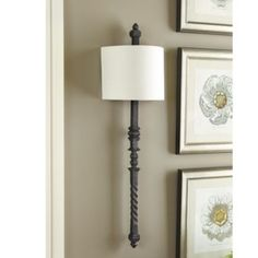 With its intricate detailing and hand-rubbed rustic finish, our Cartagena Wall Sconce mimics the look of found vintage railing and brings a sophisticated architectural look to an entry or dining room.