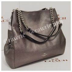 """New Coach chain phoebe gunmetal leather hobo 100% authentic. Gunmetal gray pebbled leather with silver tone chain and hardware. Three separate compartments with center zip compartment and front and back snap closures. Fabric lining and inside zip and slip pockets. Handles drop 9"""". Measures 13"""" (L) x 11"""" (H) x 5"""" (W). Brand new with tags. Comes from a pet and smoke free home. Coach Bags Shoulder Bags"""