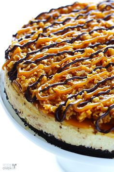 """Samoa Cheesecake Recipe ~ inspired by the famous Girl Scout cookies (a.k.a. """"Caramel DeLites""""). It's a simple vanilla cheesecake base, made with an Oreo crust, and topped with caramel, toasted coconut and drizzled with chocolate... Fabulous!"""