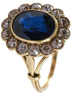 Art Deco 18k yellow gold, sapphire and diamond ring.  Approximately 3 ct sapphire surrounded by 1.40-ctw diamonds. 3.3 DWT.