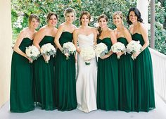 Love this color green for the brides maids!! perfectly matched bouquets too--mainly white flowers.  Perfect for my winter wedding vision!