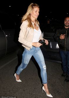 Hot mama: Heidi sported a beige leather jacket over a white top, distressed cigarette jeans and a white t-shirt.