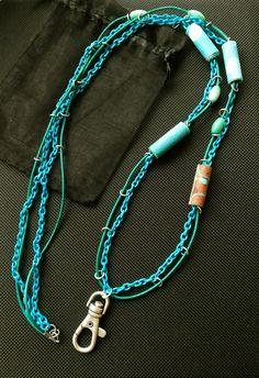 Key chain: textile beads, tagua beads, chain, leather cord. Designed and made by Peppina Pöyhönen.