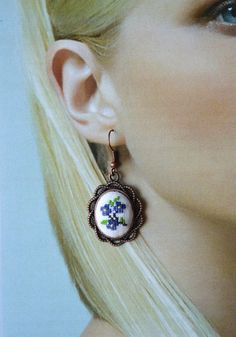 Earrings with cross stitch floral pattern. They were embroidered by cotton embroidery floss. Thank you for stopping by! Length of earrings 4.5cm (1.8