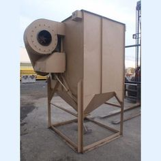 Baghouse Dust Collector.  4 ft. x 5 ft. x 5 ft.  30 in. taper to 6 in. x 6 in. discharge. 20 in. diameter paddle shaft blower.  10 hp drive motor.  230/460V.     Type 17...