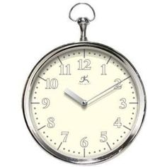 """This wall clock resembles an oversized pocket watch. Arabic Numbers surround the dial at every hour. Features a white dial, silver frame and silver metal hands. Operates by a highly accurate quartz movement and one """"AA"""" battery, not included.   Our Price: $30.00  Availability: In Stock"""