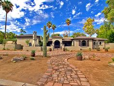 Desert Beauty and old-world style.  HGTV. I live in the desert southwest and this type of xeriscape can be beautirul.  Look at the color of the sky.
