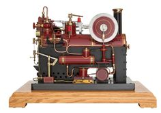 LIVE STEAM EXHIBITION MODEL HORIZONTAL ENGINE  18 x 23 x 15 inches (45.7 x 58.4 x 38.1 cm)  Finely engineered and presented scratch built scale model single cylinder horizontal engine with over type compact boiler,