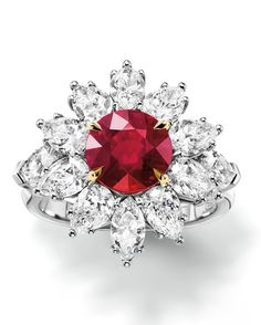 Harry Winston Oval Ruby Ring with Marquise-Cut Side Stones, Ruby 6.53 Carats, Diamonds 1.6 Carats, Set in 18K Yellow Gold and Platinum, price upon request, HarryWinston.com.