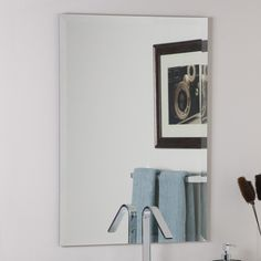 Shop Decor Wonderland 23.6-in W x 31.5-in H Rectangular Frameless Bathroom Mirror with Hardware and Beveled Edges at Lowes.com