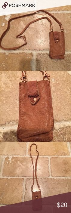 """Free People tiny bag Leather bag measures 5"""" X 3"""" strap has clasps 18"""" long. Can fit cash and credit cards at festivals and concerts. Can fit IPhone 4 size phone Free People Bags Mini Bags"""