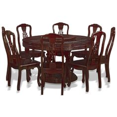 54in Rosewood Chinese Coin and Clouds Motif Round Dining Table with 8 Chairs. Chinese coin and clouds motif is hand carved throughout the surface of the table. Dark cherry finish. Oriental Rosewood dining set.