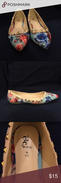 Pointed floral flats Pointed floral flats with gold studs. Never worn. Like new! Size 7/8, I wear a 7 and they fit fine. Rue21 Shoes Flats & Loafers