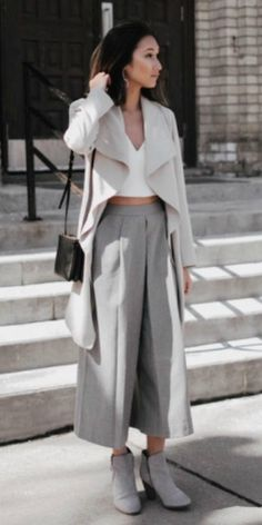 A gorgeously sophisticated spring look + Tina Hu + flared grey culotte trousers + cropped white top + cream overcoat + heeled suede boots.   Top: Aritzia, Trousers: Zara, Bag: Celine, Shoes: Cole Haan.