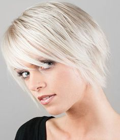 Long wispy bangs on a choppy bob gives this pale blonde cut a rocker chick edge. - See more at: http://www.short-hairstyles.com/short/s22.htm#12