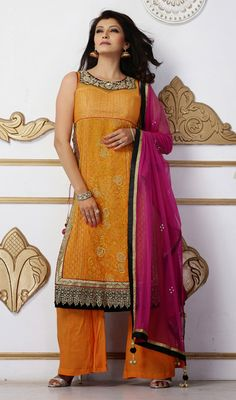 Orange Georgette and Net Salwar Suit Attract the spotlight among the crowd donning this orange georgette and net salwar suit. The chikan, resham and stones work appears to be like chic and great for any celebration.  #DesignerLadiesSuits #AnarkaliBridalSuits