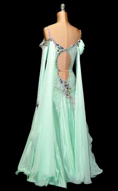 Oh wow . . . a mint green ballroom dancing dress. Now to figure out what to dance to . . .