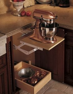 #Cultivateit with great appliances. Oh my--I didn't know that Kitchen Aid Mixers come in a copper finish! It's almost too gorgeous to hide away in this clever storage cabinet.