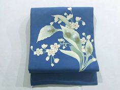 This is a Shioze Nagoya obi with a design of 'sakura'(cherry blossom) like flower, which is dyed