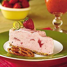 Spiked Strawberry-Lime Ice-Cream Pie This top-rated pie recipe features a unique combination of salty pretzel crust and sweet strawberry ice-cream. Garnish with lime rind curls, fresh whole strawberries and pretzels for a pretty presentation. Lime Ice Cream, Ice Cream Pies, Ice Cream Treats, Cream Cake, Frozen Desserts, Frozen Treats, Just Desserts, Delicious Desserts, Icebox Desserts