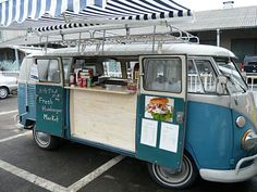 A non-modified VW bus with counter added inside. Counter space below could also have thin gutter shelves for display. Being a van already means no need to buy a separate car like a trailer.