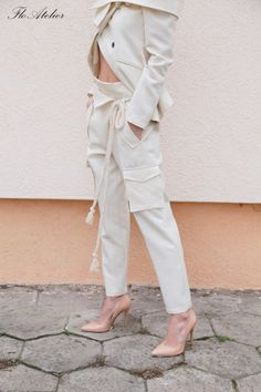 This beautiful pants are crafted from high quality fabric mixtured of linen, viscose and silk. These harem-style pants have a comfortable rope belt and slanted welt pockets. This pair is cut in a relaxed, dropped crotch silhouette that tapers flatteringly towards your ankle. Wear them with