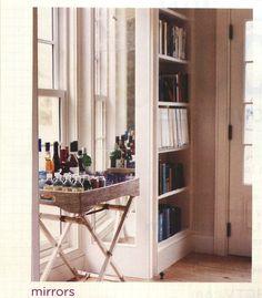 Mirrors on bookshelves