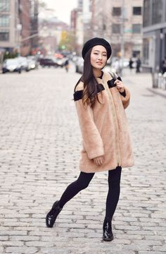 Faux fur coats have been a major trend this winter and this one is easily my new favorite. I love the blush pink color, the crazy soft faux fur, and the accent black stripe across the back. A colorful coat like this one not only chases the winter blues away but really brings a pop to your outfit. ❤️❤️❤️   Faux Fur Jacket   Faux Fur Coat Street Style   Faux Fur Coat Oufit   Paris Style Winter   Paris Street Style   Beret Hat Outfit   Chelsea Boots Outfit