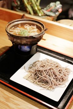 NYC's Best Cheap Eats ($10 Or Less!) #refinery29  http://www.refinery29.com/cheap-eats-nyc#slide9  Cocoron Soba Impeccably fresh, deeply nutty soba is the name of the game at these diminutive Japanese noodle shops. The stamina soba ($10) is true to its name — a sustaining warm, bonito-based broth rich with sliced pork and chicken meatballs. Don't sleep on the silky tofu ($5), either — it's made in-house daily.Cocoron Soba, 61 Delancey Street (at Allen Street), #1; 212 925-5220.