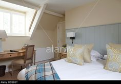 Perfect for my bedroom! Bedroom with blue tongue and groove headboard, Barnsley, UK. Stock Photo