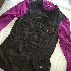 *MUST HAVE!* Amazing Monoreno Vest! A boutique purchase! Zip front, gathered waist, pocketed best in a dark slate grey (almost black) smooth sheen material. Lined in soft fleece. Ruffle detail hides zipper. Button detail on back. Shown over magenta shirt - not included. Worn and washed only a couple of times. Like new. Too small for me. Automatic 15% off on bundles. I am also happy to create custom bundles at discounted prices, as well as consider all reasonable offers. monoreno Jackets…