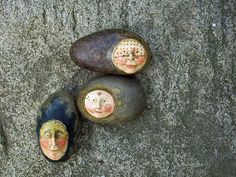 The faces are paperclay sculpted onto smooth pebbles.