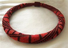This site has many beaded crochet patterns....love this increase/decrease in thickness.