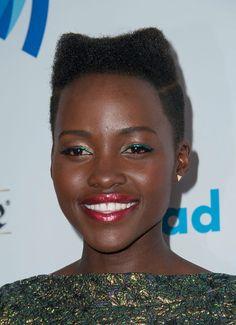 Lupita Nyong'o looking flawless in an emerald Antonio Berardi frock and eye-catching makeup