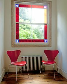 Ant chairs by vivid leaded light window