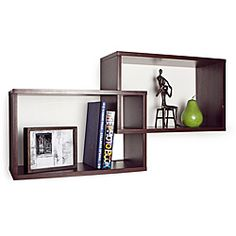 @Overstock.com - Intersecting Walnut Rectangular Shelves - This decorative wall shelf in a walnut finish laminate is composed of two boxes that intersect with each other, and can be hung vertically or horizontally. This shelf is the ideal accent for any living space.  http://www.overstock.com/Home-Garden/Intersecting-Walnut-Rectangular-Shelves/6308405/product.html?CID=214117 $30.04