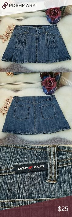 """DKNY Pleated Denim Mini Skirt EUC - Looks like the day I bought it! It has a slight stretch to it, it's well made and has 2 front pockets and 2 back pockets. It says Size 1 but can fit a 0 or 00, XS or XXS. This skirt sits on your hips like low-rise jeans. Measures 14"""" in. across the top and 17"""" in. around the middle where your butt will be. Dkny Skirts Mini"""