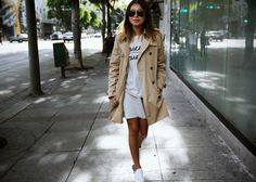 Spring has sprung! Tee: http://shopsincerelyjules.com/collections/frontpage/products/coucou-tee Skirt: http://rstyle.me/n/ww8gv9sx6 Trench: http://rstyle.me/n/ww8iv9sx6 Sneakers: http://rstyle.me/n/ww79r9sx6