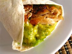 Chicken and Mango Guacamole Wrap - Adding sweet mango to creamy guacamole is simply amazing and it goes really well with spicy grilled chicken in a wrap.