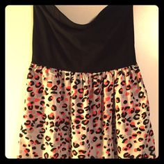 XXI Strapless Black and Cheetah Dress - size large Condition like new! XXI brand. strapless cotton black top (straight across on top when not on hanger). Cheetah print with black, gray, and a salmon/pink on bottom. Size large. Above knee length. XXI Dresses Strapless