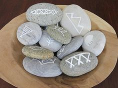 American Indian party for 6 year olds. Pebbles painted with traditional symbols...hidden as part of a treasure hunt then brought back to the 'camp fire' for a story telling game. Each child added to the story by incorporating the element depicted on the pebbles they found.