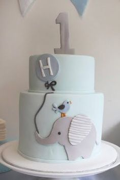 This is absolutely adorable Elephant Happy 1st Birthday Cake....really liking the blue bird and elephant for boy.