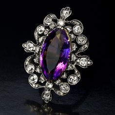 An antique Victorian era ring features a marquise-shape royal purple amethyst set in an openwork ornate frame embellished with approximately 3 carats of old cut diamonds. The amethyst is likely of Siberian origin. Amethyst And Diamond Ring, Amethyst Jewelry, 14k Gold Ring, Rose Cut Diamond, Diamond Jewelry, Purple Amethyst, Uncut Diamond, Diamond Pendant, Victorian Jewelry