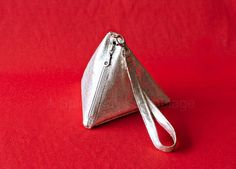 Keep track of your valuables with this pyramid-shaped wristlet. | 47 DIYs For The Cash-Strapped Music Festival-Goer