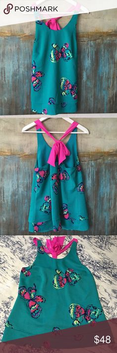 Lilly Pulitzer Ive Got Butterflies Tank Size Small Super cute Lilly Pulitzer Ive Got Butterflies tank, slinky feel with light layers, vibrant print and tie back. Size Small. Color Multicolor. Material Poly/Spandex. Measurements shoulders: 10, pits: 15, top to bottom: 26. Lilly Pulitzer Tops Blouses