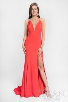 Minimalistic v-neck gown in stretch crepe. The smooth-fitting mermaid body is accented by double spagetti straps on top. Finished with a high slit and dramatic long train. Comes in red orange, lavender, chartreuse and turquoise. Choose from our selection of sexy prom dresses online