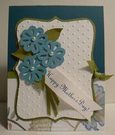 This is a card I made for our daughter. It features the Top Note die cut, Perfect Polka Dot embossing folder, Blossom Bouquet Triple Layer Punch - all from Stampin' Up.
