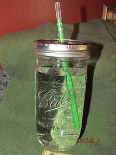 These are great for travel mugs. They are glass too so no more plastic!  Wide mouth mason jar tumblers by FourVissers on Etsy, $12.00
